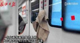 武漢地鐵上一件孤獨的風衣火了!評論區笑倒一片:這就是生活